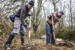 Volunteers help out at Upper Snow Creek Forest Preserve. Photo by Charles Espy