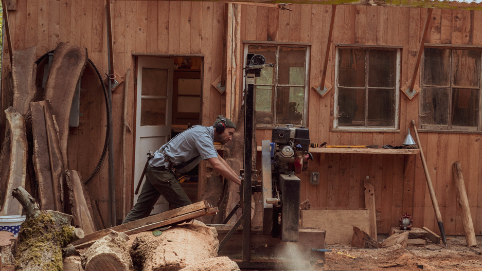 Photo of Cody Wayland and his sawmill.