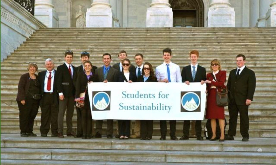 """Image of a group of high school students and few adults holding a banner reading """"Students for Sustainability"""" on the steps of a federal building."""