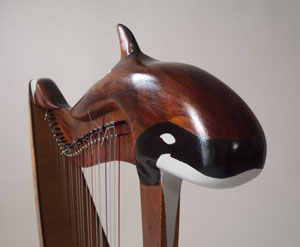 Photo of a harp with an orca carving by John Edwards.
